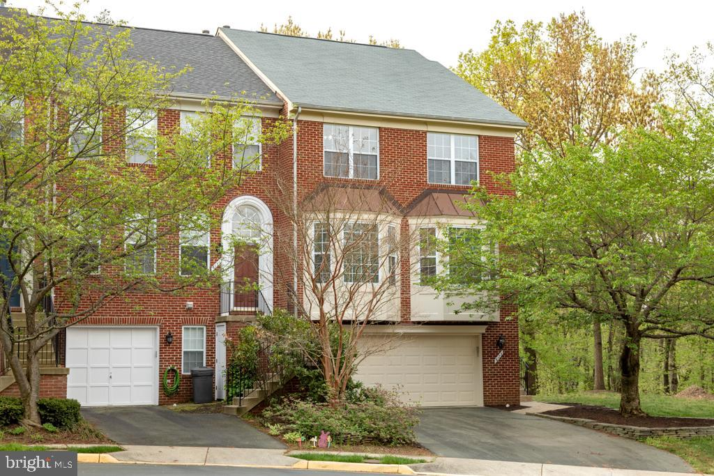 Welcome to 6173 Windham Hill Run, a gorgeous Keats model townhome sited on one of the most desirable streets in sought-after Kingstowne.  This lovely brick-front end-unit home backs to lush trees and has dazzling hardwood floors on the main and upper levels.  Showcasing a well-designed open floorplan, it features both classic and current tasteful finishes throughout.  The master bedroom features a dramatic vaulted ceiling and private master bath with an extravagant walk-in closet.  The remarkable lower level feels nothing like a basement with an impressive wall of windows.  Step out and unwind on the landscaped private patio and fenced-in yard.  From the elegant moldings, updated lighting and fresh paint to the relaxing fireplace and large deck, this one has it all.  Ideally located, this fine residence is close to all the exclusive Kingstowne amenities and is a short drive from popular Wegmans, two Town Centers, Metro and Old Town Alexandria.