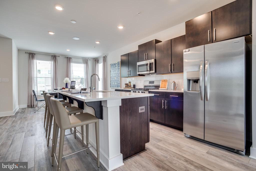 The Residence at Roland Heights is Baltimore's newest and most exciting new home community. Walking distance to the avenue at Hampden and Union Collective, and only minutes to Woodbury, Roland Park, John Hopkins, Loyola, The Baltimore Zoo and the inner harbor. The Community is situated directly off I-83 and is a commuter's dream. Tie together the best of both worlds with new home construction, a home warranty for peace of mind, Baltimore City living, and the versatility of being close to all your favorite shops, restaurants and bars. Explore Historic Baltimore while also living in a modern, smart home integrated luxury townhome. Homes in this community feature Full Brick Front Elevations, Smart Home Tech Package, Large Quartz Island, rear deck, Luxury Plank flooring on lower and Main level. Oak Staircase with iron spindles, Gas Stainless Steel Appliances. Homes offer optional 4th level loft with rooftop deck so you can make the most out of your space.