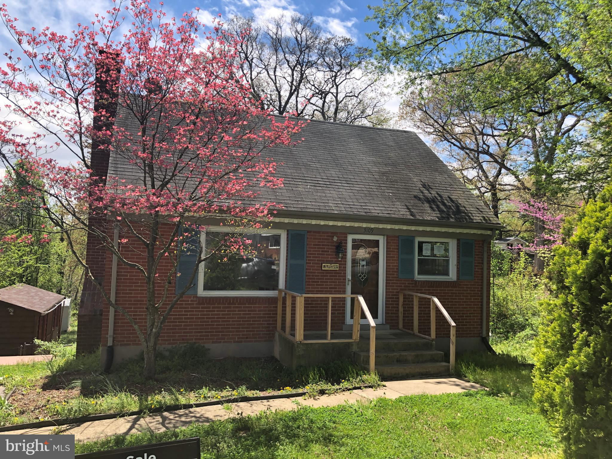 SOLD STRICTLY AS-IS. Great Opportunity to Own This Cape Cod. Fireplace, Wood Flooring, Tiered Deck, Shed, Close to I-95, Shopping, VRE.