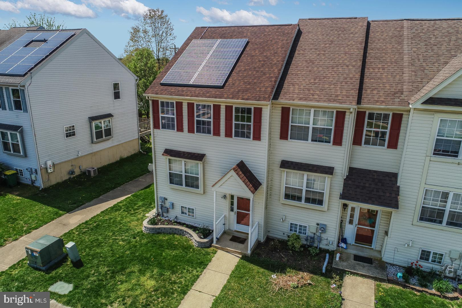 Just in time for a summer purchase, here is the home you have been looking for! Check out this great 3 Bedroom townhome located in Appoquinimink school district. This location in Middletown, Delaware is wonderful! You can walk to shopping, restaurants, parks, annual parades, and carnivals.  This end unit stands out on the street with the raised flower bed out front.  The first floor features a large great room with access to your rear deck. There is a breakfast bar separating the kitchen from the dining space and great room. The open floor plan allows easy entertaining throughout this level. You will love this kitchen with white cabinets, updated knobs, cabinet crown molding, tiled floor, and brand-new stainless appliances (April 2019)! There is also a half bath located on the main floor. The upper level has a large master bedroom with vaulted ceilings which really makes this space comfortable. This room also features a large closet and ceiling fan. There is a shared full bath and two more bedrooms located on this top floor. The basement has been finished into a large rec room and a half bath has been recently added (2017).  There is even a mini wet bar added (2017), which makes this a perfect rec room.  This basement could be a movie room, toy room, game room, or whatever your heart desires. A convenient walkout door allows easy access to your backyard. The backyard has new fencing (2018) and new sod was just laid with a rain bird irrigation system.   What a great spot for your first BBQ! The leased solar panels will keep your utility bills lower, and the roof is only 4 years old. There is a $50 a month solar panel lease fee. Other features include a nest thermostat, new high efficient slider door (2016), and updated air conditioner (2015). Set up your showing today.