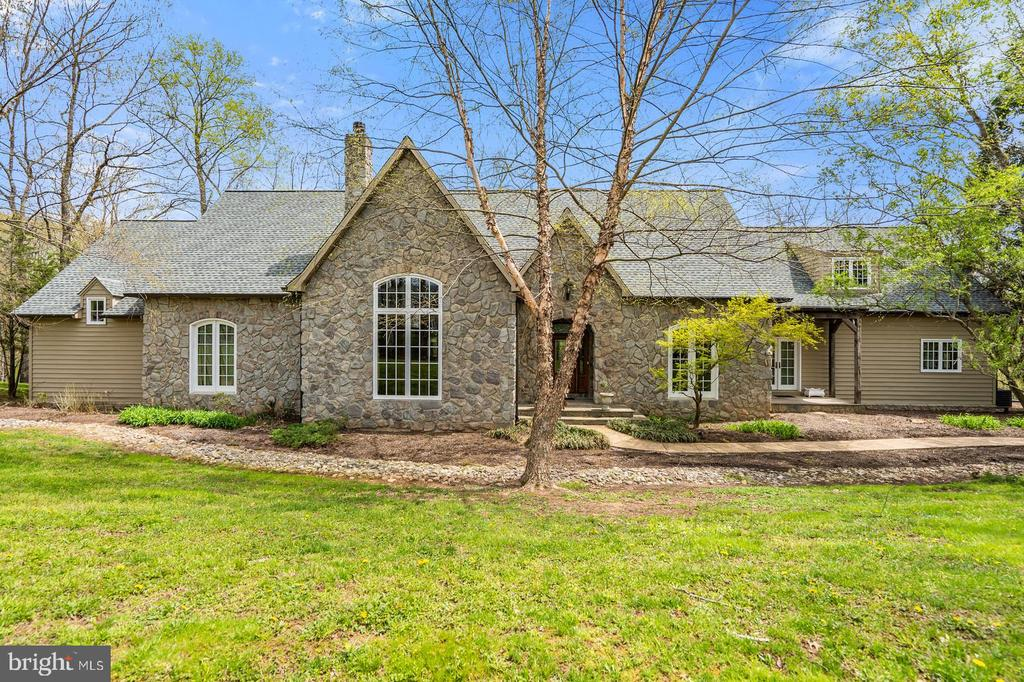 Lovely custom built French Provincial House with NEW PRICE!  Minutes to Middleburg, located  between Middleburg & Aldie. 4 bedrooms, 4.5 Baths.Generous sized rooms, open airy floor plan, high ceilings; hard wood floors;3 gas fireplaces; 23' x 15' Screened in covered porch & large deck over looking Little River; attached 2 Car Garage. Quiet, private setting with pretty views~ 4.4 Acres & frontage & views on Little River. Detached Carriage House ideal for office/studio,& extra garage. Charm, character & quality! Enjoy listening and view of Little River from  the expansive deck, or large screened in porch~~Summer  is here--  if you love privacy and enjoy nature~you will  want to see this property!
