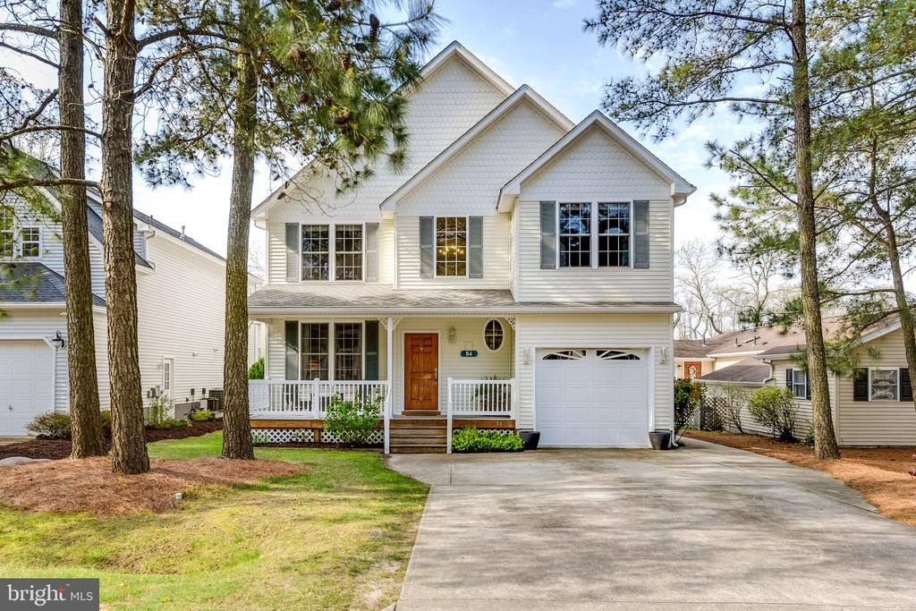 This elegant and beautifully appointed 4 bedroom/2.5 bath waterfront home in Ocean Pines will impress even the most discerning buyer.  The open concept floor plan with formal and informal dining spaces is perfect for families that love to entertain.  The family room captures a panoramic view of the canal and the 75' dock with canoe lift located just steps from the back door.   The extra large master bedroom is a must see with generous seating and sleeping space. Multiple decks off the 1st and 2nd floor allow for amazing views and outdoor entertaining. The upstairs bathrooms were tastefully remodeled with designer touches in 2017. A newer HVAC unit was installed on the 2nd floor a few years back along with brand new carpet and tankless hot water heater in 2018. Massive attic for additional storage.