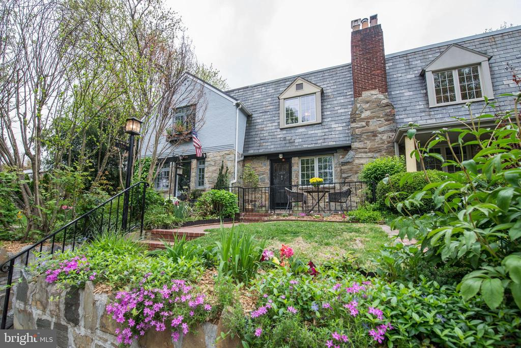 Open Sat (4/27) & Sun (4/28) - 2-4pm. Welcome to 1304 Michigan Avenue, where the city feels warm and welcoming. Originally part of Fagelson Farm, these darling homes were designed with a little extra charm. This distinctive, sought after neighborhood, is rich in history and a shining example of tudor architecture. Walking distance to restaurants, shopping and all that Old Town Alexandria has to offer.This expanded, three level row home, includes a walk-out basement and extra storage options. The main level lives larger than most with two living areas. The added den allows owners to have both a formal living area as well as casual living options on the main. The spectacular bright white kitchen features tiered granite bar-top seating, great for quick casual dining. Updated kitchen and baths make this home move-in ready. Hardwoods on the main and upper level glisten! The basement provides a flex space for the new owner. This wonderful area can comfortably host overnight guests or be  customized to suit your personal needs.This gorgeous row home offers a turn-key option, however the real eye candy can be found in the tranquil picturesque back yard space. This perfect outdoor oasis will relax and rejuvenate all who visit. A sweet canopy of trees give you just enough shade cover to enjoy the outdoor space all Summer long. Whether you host the neighborhood holiday party or a hot Summer bar-b-q, this home provides the perfect backdrop. Visit and see for yourself. This is it!