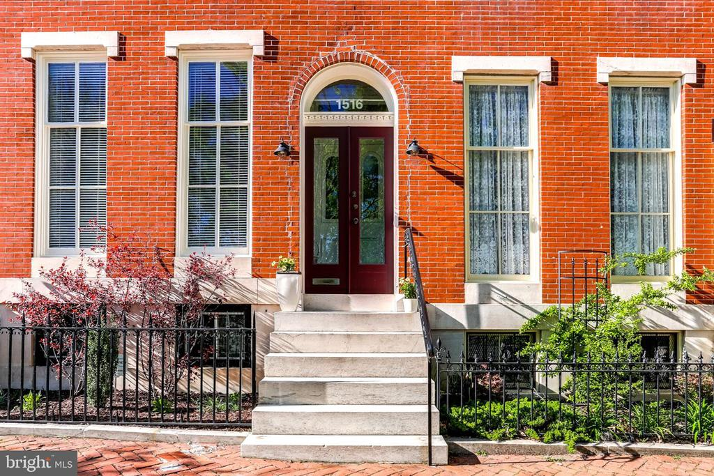 Amazing 3-Bed / 2-Bath Home on the Park of Baltimore~s Historic Union Square. Qualifies for Univ of MD Baltimore $18,500 LNYW Grant! Prepare yourself to fall in love with this house! 4-story rowhome boasts over 2600 square feet of beautiful living space. Living room showcases refinished original wood floors, original crown molding, 10~ tall windows and contemporary ventless fireplace. Spacious formal dining room displays refinished original wood floors, original crown molding and decorative fireplace. Eat-in kitchen has granite countertops, SS appliances, 42~ tall cabinets. Contemporary steel, window-paneled door installed in 2015. Two very large bedrooms (one with sitting area), full bath with clawfoot tub, and laundry room (new washer/dryer 2016) rest on 2nd level. Breath-taking master suite located on the top floor features spectacular views of the park. Ample closet space plus four 8~ tall stylish wardrobes (convey with home). En suite bath with clawfoot tub, separate subway tile shower, and vanity. Nearly 600 square feet of storage space in basement. Shelving units convey with house. Large private backyard with cement and brick patios and lovely flower gardens. Brick exterior newly painted in Fall 2018. New wooden fence installed in 2017. Active and Inviting Community.  Progressive dinners, art shows, musical performances, yoga and many other activities in the park and nearby. Best Neighborhood Association in the City.Great Location. Plenty of on-street parking. 1 mile to downtown, minutes to 95, Baltimore Beltway, and I-83.