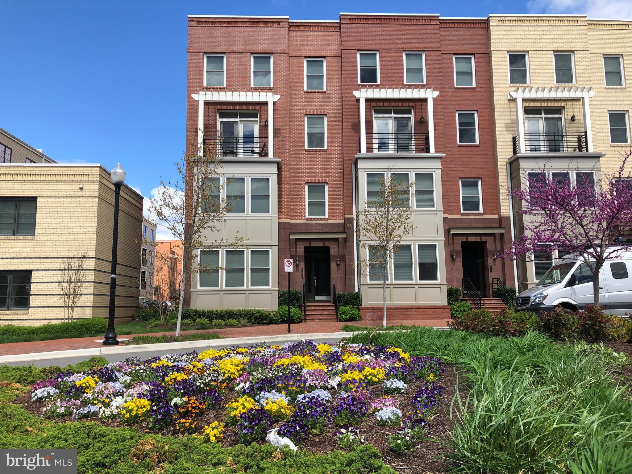 """Location!.- This Large and bright 3 Bed/2.5 Bath END unit -5 year old construction - is conveniently located, close to Braddock Metro, a block away from the bus """"Metroway"""" to Crystal City, future home of the Amazon headquarters. Only 4 blocks away from the """"The Avenue"""" in Del Ray Alexandria with restaurants like Evening Star and Del Ray Cafe plus shopping. This townhome/condo built in 2014 has state of the art appliances, high ceilings, two private balconies, and private garage. The large Master suite includes a huge walk-in closet. Large open kitchen/family room area with two-sided gas fireplaces onto Dining/Living Room space. The famous Potomac Yard park with it's Famous Children's playground and tennis courts is only blocks away. Don't miss this opportunity to own in this community."""