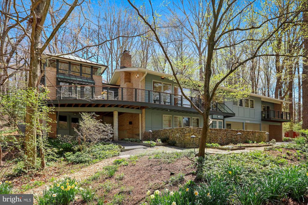 Expanded and remodeled by award winning architect, Mark McInturff -Maple and Cherry woodwork in upper entry and tower room.- Brazilian Hardwood Deck - Blue Stone Patio - This is a Master Piece -