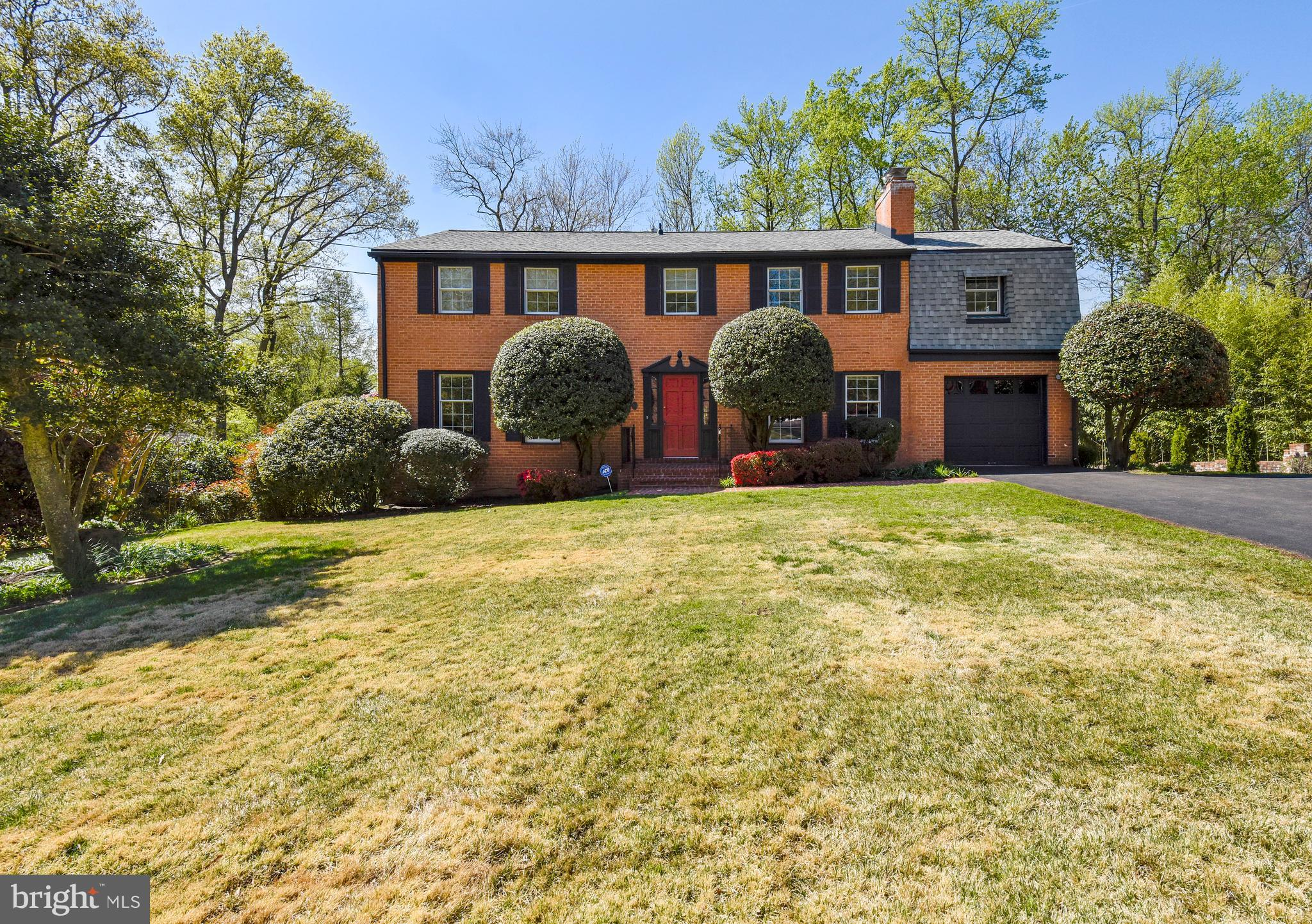 Traditional Federal Colonial elegantly sited on approximately one third, fenced, treed, landscaped acre. All brick with shutters, and new architectural shingle roof with 50 year warranty.  Rear sundeck with stairs to spacious entertaining patio. Hardwood flooring on main and upper levels, double pane Pella windows throughout, three full levels equaling more than 4000 square feet. Spacious Formal Living and Dining Rooms, fabulous bay window to view backyard flowering trees lead to open Kitchen and Family Room with Fireplace.  Watch the change of season in your Solarium/Florida Room off the Kitchen. What great family time can be spent there its large enough for a crowd. Step out to the Sundeck with stairs to the yard and Patio. Roomy upper level with Master Suite which includes sitting room and Bath with additional four bedrooms and main bath. Lower level Recreation Room has Wet Bar, Bedroom and Bath with two huge storage rooms. Great place to party as it walks out to oversized patio. Under 1 mile to Fort Belvoir, Pentagon, Fort Meade with in 15-20 miles. Safeway and other shopping. 30 minutes to metro. So much more, it is a must see property!