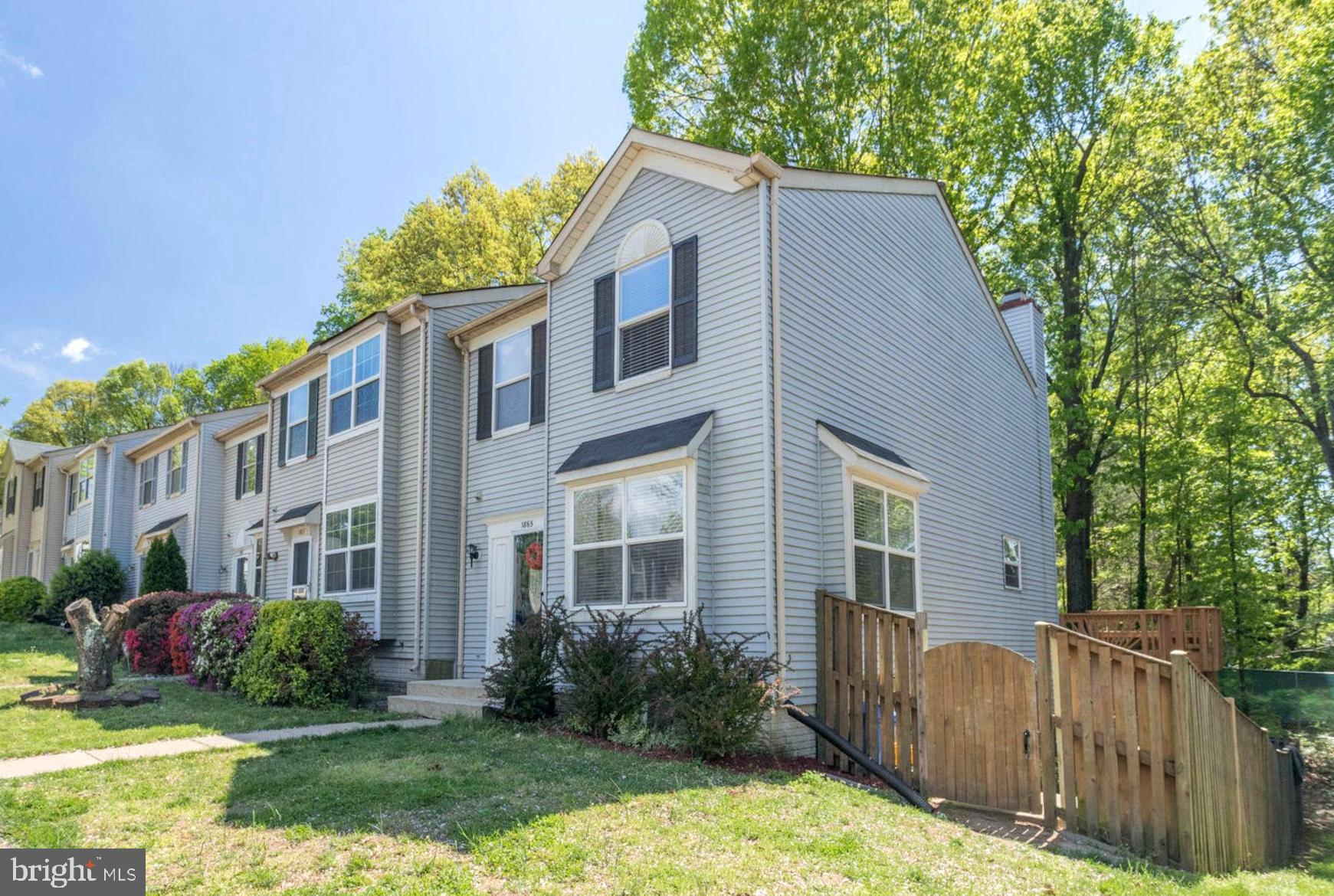 What an awesome location! SO convenient to shopping areas, schools, parks, restaurants, the Potomac Mills mall, movie theaters, fitness centers, etc.  This end unit townhome has it all! You only need to move in and enjoy! Featuring; a huge back deck off the main floor and large fenced in covered patio off the walkout basement~s living area.  The open & bright living area welcomes you into the main level of the home. The kitchen offers stainless appliances and the breakfast area tile flooring, plenty of windows overlooking the back deck and tons of counter & cabinet space.  The master bedroom, master bathroom, two additional bedrooms and a full bath round out the upstairs. The spacious basement features a family room with a fireplace, a bonus room that has so many possible uses, a full bathroom and laundry space.  See this incredible property today!