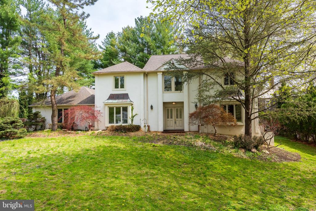 What a beautiful location to call home! On a large flat corner lot, peace and serenity await you in this much desired North-side Haverford cul-de-sac neighborhood. Here you will find this bright and sunny French Colonial with 4 bedrooms, 3.5 baths with fully finished lower level. As you enter notice newly finished hardwood floors (2019) and a grand two-story entrance. Coat closets on both sides of the double front door can house your party guests coats as they arrive. Your furniture will fit in the graciously sized living room and large dining room to the right and left of the entry hall in this beautiful & functional traditional layout. Behind the living room is a large office space that could be converted to a first-floor bedroom if needed. The family room with brick fireplace is situated between the office and an expansive kitchen with breakfast room. The updated kitchen has a center island with cook top. It is perfect for the energetic cook and boasts newer Thermador appliances (cook top 2019), 42-inch oversized refrigerator, granite counter tops, lots of antique white custom cabinetry & huge pantry. French doors from your breakfast room lead to the fenced backyard with a pool & spa and plenty of flat play area. Conveniently placed is your mudroom and laundry between the kitchen and garage entrance (2012 new garage doors) Large casement windows, many of them recently installed (2019 Anderson windows transferable lifetime warranty), allow beautiful views of the outdoors from most rooms.  The powder room and two car attached garage finish off the first floor living space. On the second floor is a large master bedroom and master bath with shower, whirlpool tub and double sink vanity. The bedroom next to the master has a brick fireplace and could also work fine as the sitting area for the master bedroom. There are two additional ample bedrooms with large closets and a newly renovated hall bath tub/shower (2019). New carpet has been installed throughout the second fl