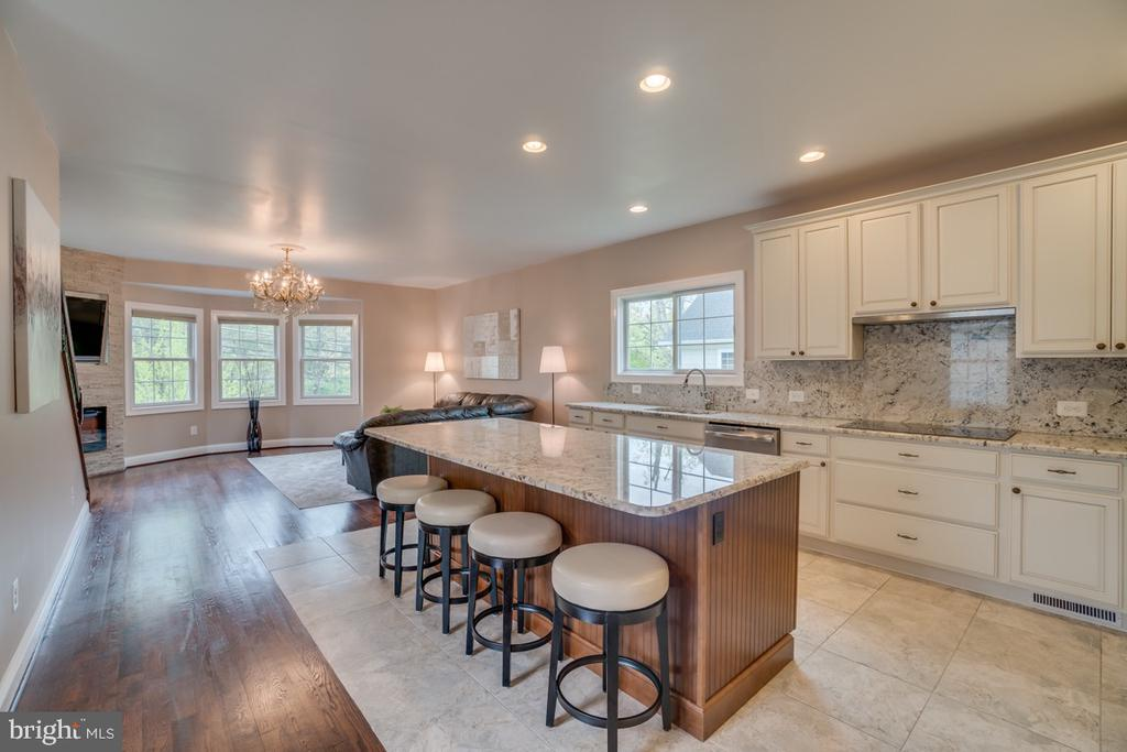 Like New, Built in 2015! This turn-key, Custom Built home features 6 Bedrooms, 5.5 Baths and approximately 3,500 Finished Square Feet of Living Space.  The interior features high-end finishes and upgrades throughout, including a spacious Gourmet Kitchen open to the Family Room with Fireplace.  Formal Dining Room, Home Office, Powder Room and Formal Living Room complete the Main Level.  The Upper Level Features a Stunning Master Bedroom Suite with Upgraded Bathroom and Walk-in Closet and three additional bedrooms. The Lower Level features an in-law/au-pair Suite with Separate Entrance, Bedroom, Kitchenette, and Living Room.  Cost and energy saving geothermal. Total electric, heating and cooling bills are less than $150/month!!!  This Home is Sited on a Fantastic .2 Acre Lot in an amazing Vienna Location, convenient to shopping, dining and everything the Town of Vienna and Tysons has to offer.  Walk to W&OD Trail. Easy Access to Dunn Loring and Tysons Metro and the Beltway will make Commuting a Breeze.