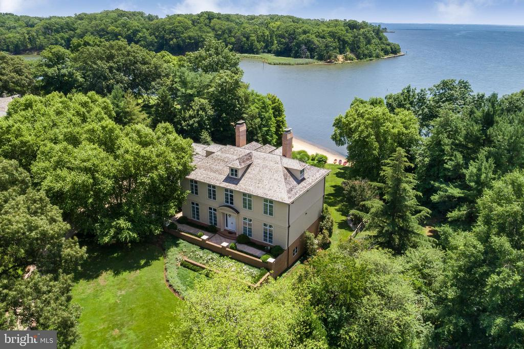 Classic European majestic estate. 9,237 Sq. ft of Elegant design with light filled, open entertaining spaces.Rich White oak wood floors, sumptuous crown moldings and finest craftsmanship.  Sun Room. Sophisticated library/music room with custom built-insFloor to ceiling wall of windows commanding sweeping ever changing Creek, River and Chesapeake Bay views.Sleek custom cabinetry. Sited amidst picturesque vistas and incredible privacy. Tranquility amongst abundance of nature.Stately court yard wtih pastoral views.2 Attached garages for 4.5 vehicles.  Au pair/guest suite with private entrance. All seasons 60 X 10 heated pool.  your own private sandy beach & 60 ft. pier.  Generator. Community marina with deep water dockage. Abundance of nature & blue herons. Extraordinary quiet & peaceful  waterfront setting.