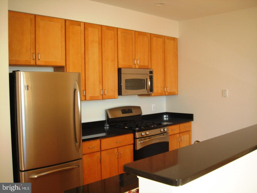 Top floor best views in the building!  Fabulous penthouse sky suite with private balcony overlooking the inner harbor! No better views.  9' ceilings, split bedroom design for max privacy.  Stainless appliances, granite counters, wood floors, gas cooking and fireplace!  Full-service building with 24-hour desk, rooftop pool, internet business center, state-of-the-art gym, and club room.  PARKING INCLUDED in attached garage.  Additional parking available.  Enjoy the high-rise lifestyle from the top of one of the most popular inner harbor condos!