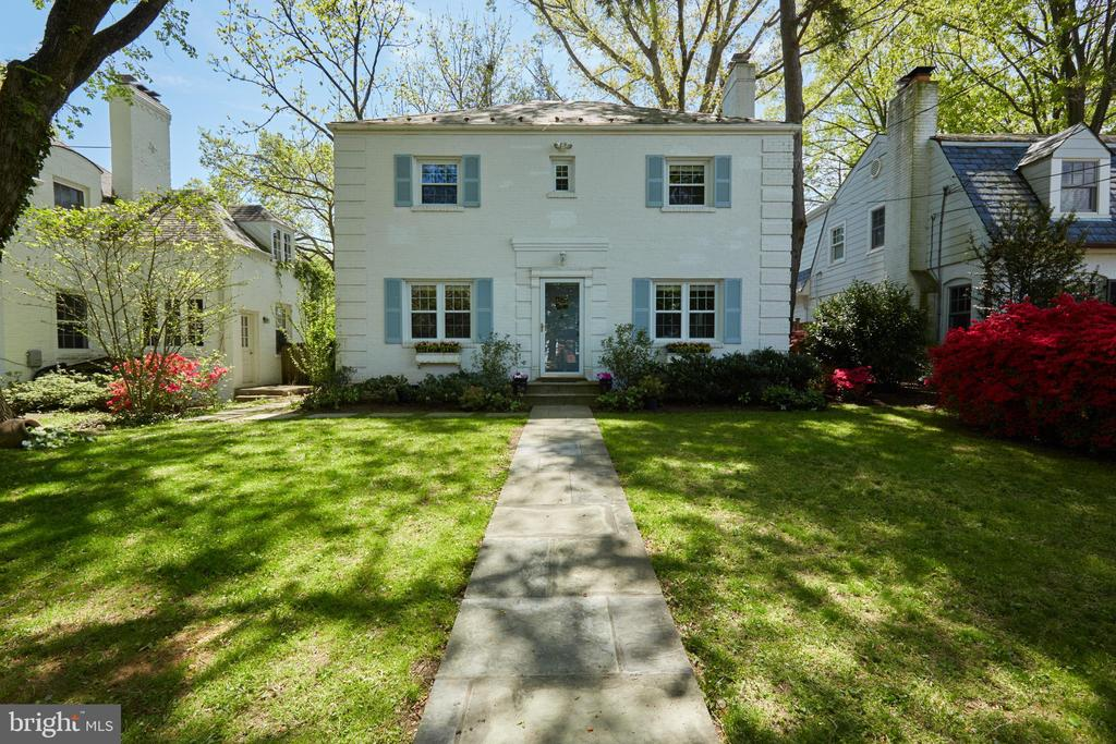 This meticulously maintained and thoughtfully updated Colonial is located in one of the most desirable streets of American University Park neighborhood.  Its traditional floor plan on the first floor boasts a generously sized living room with fireplace, dining room and a bedroom with full bath.  The kitchen has stainless steel appliances and granite counters.  On the second floor, the Master Suite has a large walk-in closet, bath with a whirlpool tub, a separate shower and double vanity.  There are two additional bedrooms with expanded closets, and a large hall bath with double vanity.  The finished lower level has laundry, two large storage closets, full bath and a bonus room/family room.  Enjoy the beautiful landscaping and fully-fenced rear yard with patio.  Two parking spaces in rear. 1 block to Spring Valley Restaurants and shops.