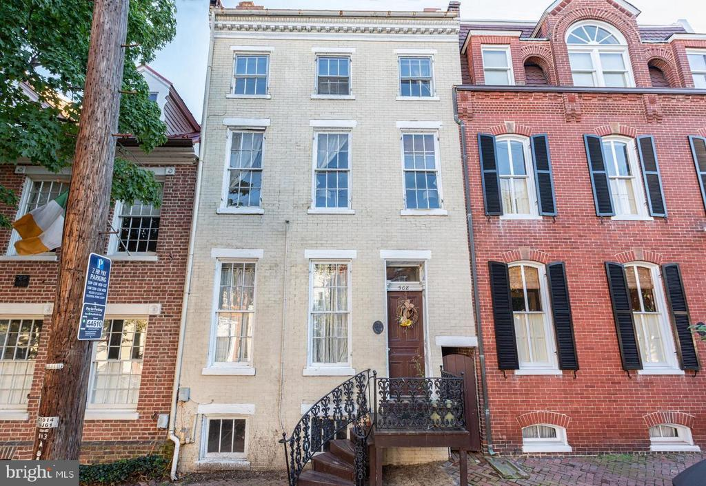 Rare opportunity! Revert this existing 5 unit rental apartment building back to a single family residence, convert to condominium or keep as 5 apartments. Amazing location, 1 block from King St. and a short distance to the waterfront. Brick building, easy street parking, and alley access.