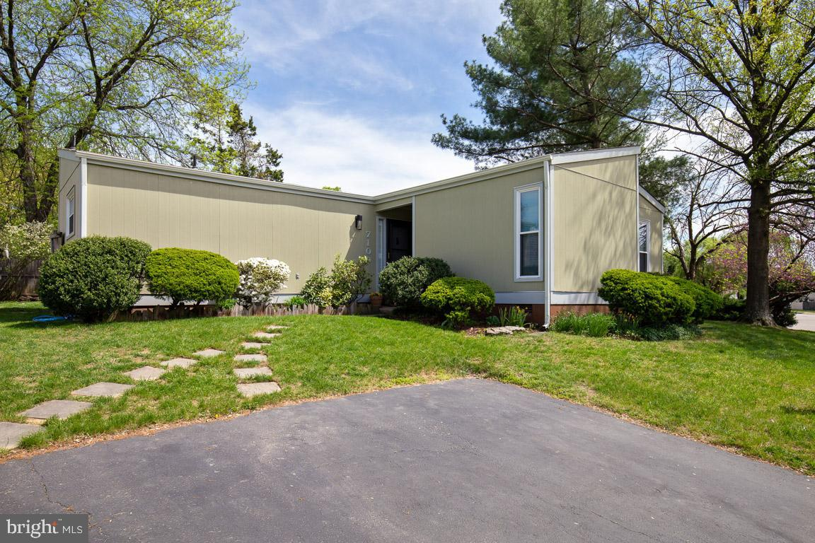 Beautifully maintained 3 bedroom 2 full bath contemporary home in incredible location! Fresh paint and new carpet throughout! Bright and airy floor plan. Open kitchen has loads of cabinet space, gorgeous tile flooring and full size washer and dryer.  Spacious living room with soaring vaulted beamed ceilings. Dining and living room step out to patio and private fenced backyard. Master bedroom has private bath and features sliding glass doors leading to private outdoor patio. 2 additional bedrooms and full bath also on main level. 2 driveway spaces and tons of street parking. New hot water heater in 2017! New paint and new carpet throughout!  Newer dishwasher, roof and siding.  Perfect lot surrounded by 2 large common areas. Hooes Road park right across the street features tennis and basketball courts, baseball and soccer fields, and playground. Great commuter location just minutes from 95, 495, 395, Amtrak and VRE. Walk to Blue Line Metro! Shopping, restaurants, and Springfield Mall just minutes away.  Walk to National Geospatial Agency.  AMAZING SUNSETS!  Welcome home!