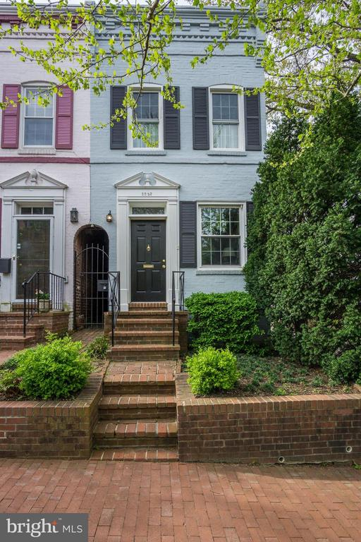 Located in one of Washington's most sought after neighborhoods, Foggy Bottom residents appreciate the classic style of the neighborhood with all of the benefits of urban living. This charming Foggy Bottom end-rowhouse is conveniently situated two blocks from the Foggy Bottom Metro, minutes from West End/ Foggy Bottom shops and restaurants, a short walk to the Georgetown waterfront, the National Mall and monuments, the Kennedy Center, Trader Joe's and Whole Foods, and one-block from the Foggy Bottom dog park and playground.This light-filled 2 bedroom, 1 bathroom home suits nearly every lifestyle and showcases contemporary touches while maintaining traditional Washington character. The home boasts hardwood flooring throughout, stunning custom built-in shelving, crown moulding, a recently renovated gourmet kitchen, exceptional outdoor space, bike storage, and parking for one car.