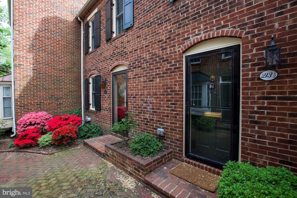 Location is a 10!  Located between King and Duke Streets; around the corner from Historic Old Town Alexandria restaurants and shops; and ~1/2 mile to King Street Metro!  No HOA or condo fee.  One assigned off-street parking space.  End 3 level TH with lots of natural light.  New gorgeous kitchen; brand new renovated master bathroom; recessed lights; hardwood floors throughout; wood burning fireplace; fenced in brick patio with small garden and separate entrance adjacent to parking space; power washed and completely painted interior and exterior. New heating, AC and roof in 2016. Offers due by noon on Tuesday 4/30/19.