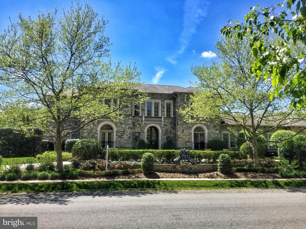 Stunning Stone Manor in the highly sought after Woodlea Mill neighborhood. The breathtaking exterior, professionally landscaped by Charles Owen of Fine Landscapes, has a Circular Driveway with pavers, Terrace with Fireplace, Patio, Water Fountains and Pergola. Interior features soaring ceilings, 1st floor Master with dramatic double barrel vaulted ceiling, 1st floor Guest Room, Kitchen with top-of-the-line appliances, Butler~s Pantry and Wet Bar. Custom designed Four Seasons Room surrounded by windows has indoor grill and bar perfect for year-round entertaining. Upper Level boasts 3 spacious and private ensuites. Walk-Out Lower Level has Recreation Room, Billiard Room, Game Room, Media Room, Fitness Room with Bath, Wet Bar with Kitchenette and Bedroom with Sitting Room and Bath.