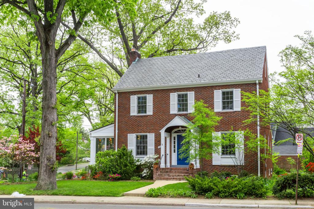 """Offers to listing agent by Noon Tuesday, May 7. Handsome, stately and grand Ashton Heights 1935 Brick Center Hall Colonial with a multitude of charms.   Slate roof.  Four finished levels.  Living Room with fireplace #1 and  built-in's.  Adjacent cheerful sun room/den adds even more comfortable living space.  Hardwood floors on three of the four levels.  Eight (8) ceiling fans... and, yes, there is Central Air Conditioning. Separate dining room, classic breakfast room adjacent to kitchen and half bath on main level.  Three Bedrooms,  Master Bath and Hall Bath on Bedroom Level and there's  even more.  Fabulous, versatile finished """"bonus space"""" in enormous walk-up attic;  abundant windows and plenty of head room.  Play room/game room/homework room/office/craft room/writer's or artist's studio...even a 4th Bedroom.  So many ways you can use this incredible space.  Full walk-out basement with recreation room,  fireplace #2,  handy built-ins,  workshop/storage room and light/bright laundry room with exit to backyard.  Patio, garage and tasteful easy-care mature plantings.  Golden location a quick walk to Long Branch Elementary, multiple parks, Lyon Park Community Center,  both Clarendon and Virginia Sq. Metro stations and close-in Arlington's many services and attractions.  This is just the kind of house you visualize when you think of North Arlington."""