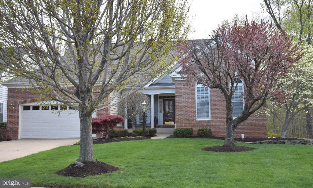 **NEW PRICE**Sought-after Lakemont model on PREMIUM LOT in 55+ Heritage Hunt*3-Levels*Roof 2017*Screened porch*Large deck*Backs to Woods*Next to large common area**Sunroom**2-sided fireplace**Lg master bdrm*New wash/dryer/dishwasher**Buyer pays $3660 Cap Fund fee at closing**Please note this is a 4-bedroom** Tax records are incorrect**