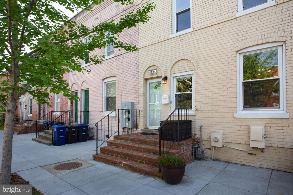 Step inside this spacious and airy row-home located on a quiet one-way street, steps from Nationals Park. The living room features a wood burning fireplace and built-ins, as well as an abundance of natural light through the front facing windows. The main level also boasts a powder room, open kitchen with stainless steel appliances, granite countertops, and breakfast nook that opens up to the dining space that is ideal for entertaining and everyday living. A bonus living space provides convenient access to the large fenced in patio and private parking spaces that have been outfitted by RiverSmart Homes.  The second level features a front facing master bedroom with two large closets and a completely updated ensuite bathroom.  Rounding out this level is the beautifully updated full bathroom and two additional bedrooms that are spacious and feature an additional nook perfect for an office or sitting space.  Perfectly located between the Navy Yard and the newly developed SW Waterfront, Metro, Yards Park, Nats Park, Audi Field, Whole Foods, and much more, this location 10 out of 10!