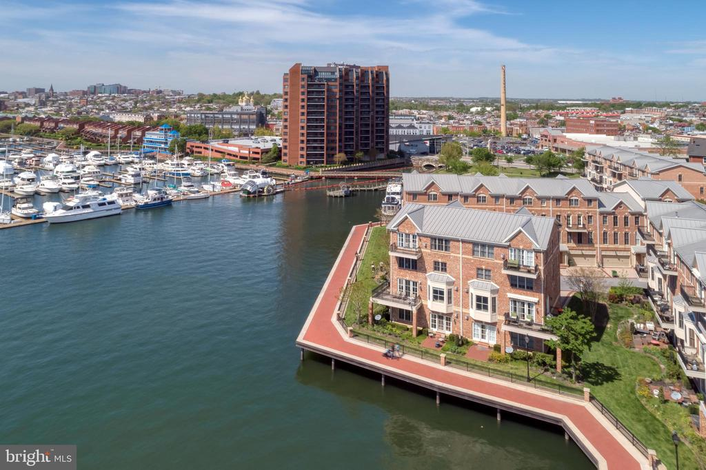 """Come view this stunning, 4 BRM-3/2 bath waterfront townhome w/over 4200 sq ft and designed w/today's living style in mind and located in the gated community of The Moorings-Enjoy the spectacular sunsets and panoramic water views from each level-A custom """"Cooks"""" kitchen w/a large center island w/granite ctop, exc cabinet storage & generous prep area-The remainder of the kitchen has SS appliances, multiple wood cabinets, 7 windows & marble flooring-A spacious MBRM suite w/vaulted ceiling, 2 sided gas FP, cherry wd flooring, bar area, balcony, awesome closet storage + a mas bath w/a glass & marble steam shower & jetted tub-A 2 car built-in garage w/add'tl 3 car parking in front if needed-Additional features: An elevator that stops on all 4 lvls; 3 gas FP's; glorious south & west views of harbor & city; 3 balconies & a brick patio; multiple heating & CAC zones; walk to bars & restaurants; backs to the promenade-Come see why the developer of this community picked this house for himself!!"""