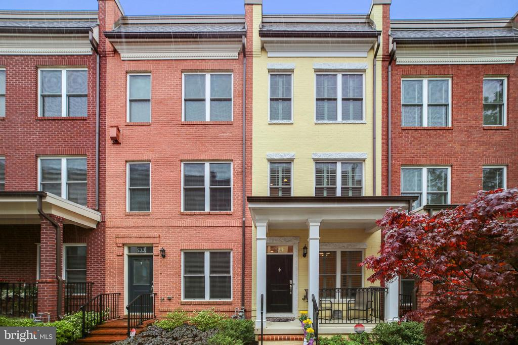 This stunning townhome at sought-after Chancellor's Row offers 3BRs/2.5BAs plus a den and garage spread over four beautifully designed levels in the heart of Brookland. The open LR/DR combination is an entertainer's dream with a well-equipped stainless steel and granite kitchen that features a large peninsula and west-facing balcony with hard-plumbed gas line for grilling (never buy propane again!). The penthouse owner's suite features luxurious sleeping quarters with a walk-in closet and sun-drenched ensuite bathroom with double vanity, while two spacious additional bedrooms one level down are serviced by a dual-entry bathroom with double sinks and a shower-over-tub. Enjoy open sky views on the roof-top terrace or watch the world go by on the charming front porch. Additional features include hardwood floors, high ceilings, high-efficiency laundry, dual-zoned HVAC, abundant storage and more. Blocks to Brookland's amazing shopping, dining and entertainment destinations along the 12th Street corridor and Monroe Street Market, with Metro, numerous bus lines and major thoroughfares offering easy access in, out and around the District. July 1 Move-In preferred.