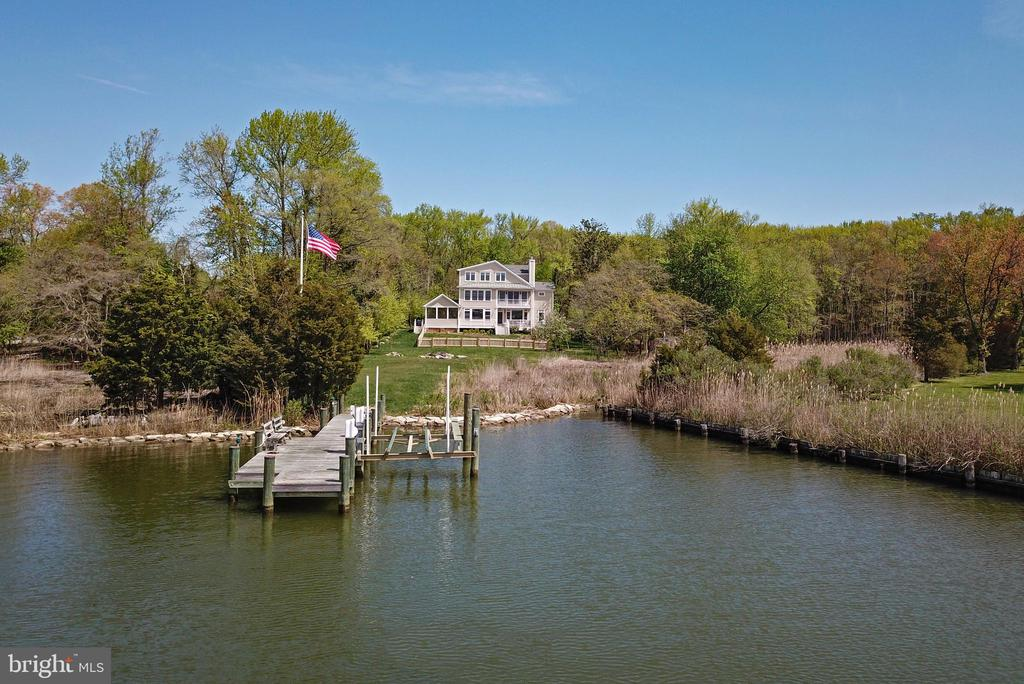 Spectacular Waterfront estate on 8.81 PRIVATE acres! Sited on Kitty Duvall Creek and opening to the South River as it flows into the Chesapeake Bay this 2014 custom built home features over 5,250 sq.ft of living space on 3 levels. The main residence features an open floor plan, gourmet kitchen, dining area, living room with wood-burning fireplace that can be easily converted to gas, large screened porch with access to built-in natural gas grill, office, and powder room on the 1st floor. A Master suite with balcony, 3 additional bedrooms and 2 baths on the second level. The huge 3rd floor with expansive views of the South River features the 5th bedroom, a full bath, and bonus area that is perfect for home office, study, gym, or au-pair suite.  The sun-filled floor plan allows for spectacular views towards the creek and beyond! The dry cellar offers 6'; ceilings, is heated & cooled, and ample room for storage & utilities. An over-sized 2-Car garage completes the main residence. A 47KW back-up generator provides power to the entire main residence. The private pier with water, electric 8,000 lbs boat lift, 4' MLW, offers easy access to the Chesapeake Bay. A newly renovated separate secondary principal dwelling unit approved by the county is over a detached 2-car garage and is perfect for au-pairs, in-laws, or rental opportunities. In addition to the 4 garage parking spaces there is additional parking for 8-cars along the driveway with paver parking area. Average utilities per month for the last 3 years is approx. $264. Minutes to downtown Annapolis by boat or car make this a must see offering! The property has been approved to be subdivided into 5 lots pursuant to letter in disclosures.  However, it has not been formally recorded by the owner as they wish to leave it up to the next owner to decide on their desire for future subdivision. The main residence lies outside of Flood Zone. All documents available upon request.