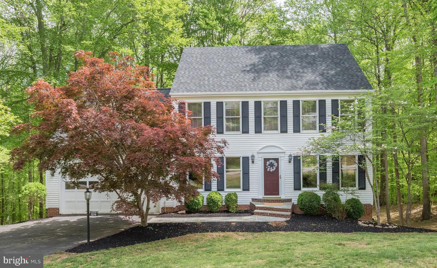 Professional photos on 4/24. Classic colonial in the Cannon Bluff Community! 4 bedrooms, 3.5 bathrooms on almost 2 acres, backing to woods and a small stream! Enjoy the peace and serenity from the 2-level deck. Nature lover~s paradise! Home is located on a quiet cul-de-sac in Colgan High School district. New roof, HVAC system and water heater. Freshly painted throughout and new carpets on the upper level. New hardwoods on main level. Gorgeous gourmet kitchen with stainless steel appliances and granite countertops. Expansive windows off the back of the home letting in lots of natural light. Separate formal living/dining rooms and home office. Upper level has a large master suite with separate sitting room. Newly renovated, spa-like bath with granite counter tops, jetted tub, vaulted ceiling, skylights and plantation shutters. 3 additional bedrooms and a full hall bath. Large, walkout, lower level rec room with full bathroom and wood burning stove. Ample room for storage. The Neighborhood Association maintains a 12-acre park with walking trails, boat ramp & dock on the Occoquan River. Canoe, boat, fish and hike within walking distance from your new home! Septic/Water/Well inspections already completed! Don't miss out!