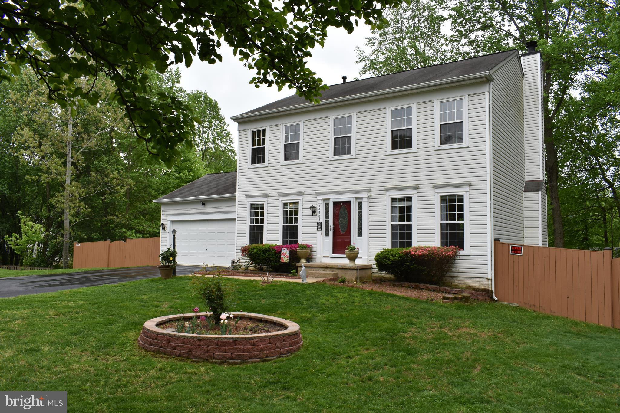 Lots of TLC here!!! You will love this 3 level Colonial that sits on a quiet cul-de-sac and has a wooded level fenced in lot.  Our backyard has a new 12x12 shed and double deck. Seller totally remodeled the kitchen from top to bottom 18 months ago. All the windows were replaced 3 years ago. The HWH was replaced 4 years ago.  The top two levels have hardwood floors throughout. Our lower level has a rec room, den, full bath and a true 5th bedroom.