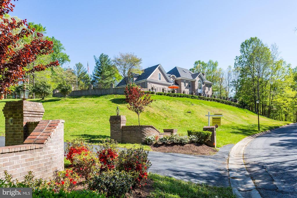 This Magnificent and Exceptionally Private 2.3 acres Bethesda Estate nestled on hill top overlooking a State Park. Spectacular custom-build house of 7,058 sft with additional 2,690 sft walk-out lower level, 9.5 ft ceilings, 2x6 all brick walls, 4 floors & every luxury: grand marble entry, Palladian style Pella windows, hard wood floors, stone terraces, gourmet kitchen, owners suite w/sitting rm, fire place, wet bar and dual dressing rooms. The north side of this lot is large enough to build another house. Both spacious and architecturally detailed, this home invites a confluence of luxury living, lavish entertainment & provides easy access to Chevy Chase, Washington DC & Tyson Corners VA.   SPECIAL FEATURES: *Lavish master suite w/fire place, wet bar, his & hers closets, oversize Jacuzzi and steam shower. *Banquet size dining room. *Formal elegant living with fireplace. *Kitchen with large casual dining room & gas barbecue fireplace. *Great room with stone fireplace and access to rear patio and balcony. *Huge front and back tiled patio. *Four (4) wood burning fire place. *New Natural Gas 200 Amps generator for backup power. *State of the art security system with voice monitoring for doors & windows motion detection. *New home intercom system. *New walkout finished lower level with wet bar and fireplace. *dual zone heating and central A/C system. *Oversize/SUV 3-car garage. *Professional landscaping and new computerized water irrigation system with sensor outdoor & sensor lighting with adjustable timer. *Perimeter wrought iron and brick pillar fencing. *New roof.