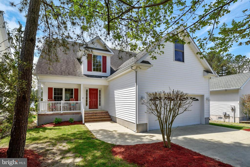 Unique opportunity to purchase prime waterfront in Ocean Pines with unobstructed views of Manklin Creek.  Bring your boat and pull into your very own boat slip complete with an 8,000 lb. lift.  Sit in your living room and enjoy the peaceful water views from the wall of windows  or turn on your gas fireplace during the chilly off season.  This home has been gently used as a second home and never rented.  Enter through the front door into an open foyer with hardwood flooring that flow right into the two story family room.  Kitchen features a breakfast bar and ceramic tile for easy clean up.  Walk out the slider onto your maintenance free deck from your kitchen and enjoy the evening sunsets over the water.  The master suite is conveniently located on the first floor completed with a full bath, double vanity sinks, walk in tiled shower and walk in closet as well as a linen closet.  Check out the bay view from the master bedroom inside our floor plan virtual tour video attached.  The second floor has three additional bedrooms and a full bath ready for all your overnight guests or family members to enjoy,  The view from the second floor bridge overlooks the family room below and wall of windows overlooking the water.  The washer and dryer is tucked away in a closet on the first floor with and a half bath nearby for guests  This home has been well maintained , HVAC system on the first floor was just replaced and the second floor unit has been  gently used.  Please call today to tour this gorgeous waterfront home.