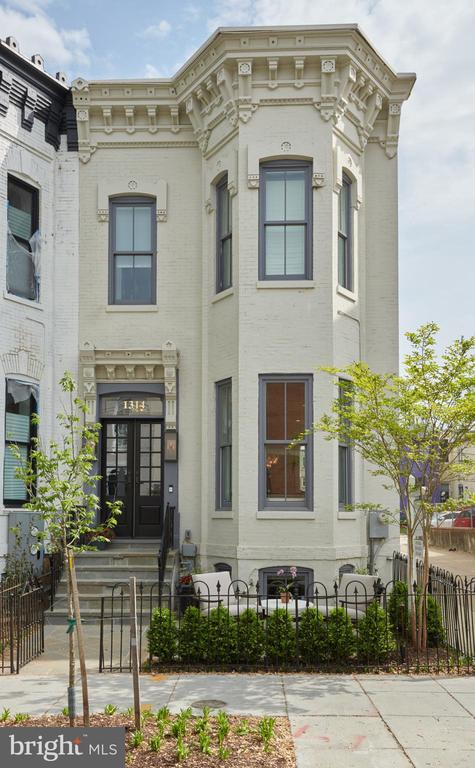 Open Saturday & Sunday,  4/27 & 4/28 from 2-4pm - Incredible circa 1890 4BR/4.5BA Victorian end-unit row home is flooded in natural light in coveted Logan Circle. Fully renovated in a showstopping collaboration between renowned architects Thomson & Cook, AIA and interior designer Martha Vicas, ASID, you will be enveloped in the ultimate juxtaposition of modern minimalism and historic styles. Every striking detail is intentional, in the form of custom millwork throughout every room, built-in cabinetry, custom draperies, herringbone stone entry, original exposed brick, custom-cut Stark carpeting, custom flooring, Waterworks fixtures, and custom interior and exterior lighting to name a few. Upon entering the spacious home, you will be immediately taken by the incredible layout and view through the length of the main level with three striking archways dividing spaces. The main level family room opening to the back patio will surely be a wonderful spot for relaxation in the home. The kitchen is crisp and bright with abundant storage and counter spaces, a chef's kitchen with a commercial Miele appliance suite, hand cut clay tile backsplash, custom cabinetry, two wine refrigerators, and a original exposed brick archway that will delight even the most discerning. All of the spacious bedrooms feature en suite bathrooms with custom finishes, cabinetry and natural stone tiling. There's also the option for two car GATED PARKING for the automobile enthusiast.  Logan Circle residents value the beautiful historic architecture, self-contained nature of the neighborhood along with endless retail, dining, and entertainment options. Nestled between Dupont Circle and Shaw with quiet elegance, it is easy to see why Logan Circle is in demand. Steeped in history with beautiful public and green spaces. Residents also have ample commuter options nearby.