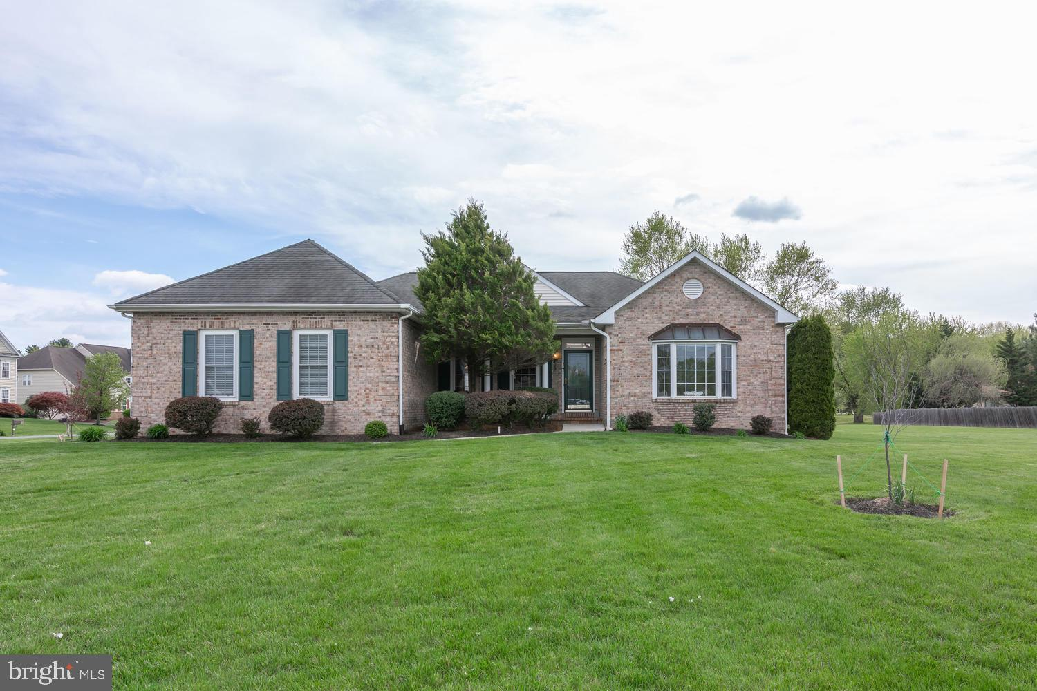 "Welcome home to the Estates at Farmington!  Located in the sought after Appoquinimink School District, this charming brick property sits on a half acre corner lot and has a first floor master suite! Enter through the front door to a formal dining room with custom mill work on your left and a living room with crown molding and expansive bay window on your right.  The family room has an open floor plan, gleaming hardwood floors and cozy fireplace.  Enjoy the clean as a whistle eat-in kitchen with crisp white 42"" cabinets and stainless steel appliances.   Lots of cabinetry and counter space!  Two spacious bedrooms with full bath are situated on one side of the home while the master suite is on the opposite side.   The expansive master suite has a tray ceiling, sitting area, private master bath with dual sinks, shower and whirlpool tub, a great place for a retreat after a long day!  A large laundry room sits just off the hallway from the master bedroom.   Deck with Sunsetter awning awaits for weekend barbecues!  There is an in-law suite that has its own private entrance from the outside!  If you have a family member that wants independence but still desires to be close, this additional living area is ideal!  Sitting and eating area plus a FULL kitchen are in the main room.   HUGE bedroom with a walk-in closet and full bath complete this area.   There is a large storage space for possibly a exercise area as well in the basement.   Lots of possibilities!  You will not find another home like this in the area!"