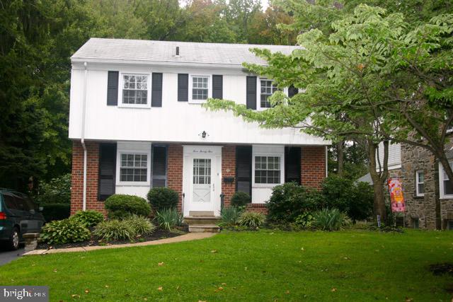 Classic 4 Bedroom Colonial w/ numerous updates on beautiful, deep lot. MAIN LEVEL:  Entry way, large Living Room w/ gleaming hardwood floors, stone fireplace, sliders to covered rear flagstone porch, Dining Area w/ hardwood floors, White Kitchen w/ granite peninsula breakfast bar, recessed lighting, door to rear plus partial Bath. UPPER LEVEL: Master Bedroom w/ 2 double closets & Half Bath, 3 Additional nice size Bedrooms w/ double closets, C/T Hall Bath. BASEMENT has large Family/Play Room, Powder Room, workshop w/ walk in closet, Laundry Area. Deep Back yard is like a park, deep, gentle slope towards the rear w/ small creek. Covered Rear Porch overlooks the entire property. Long Private Driveway, replacement windows, Gas Heat, Central Air, refinished hardwood floors,  This well cared for home is ready for you to move right in and enjoy Spring & Summer activities on your nearly 1/3 acre lot. Yes, this property crosses the footbridge all the way in the rear.  Close to shopping & transportation. Award winning Springfield Schools.