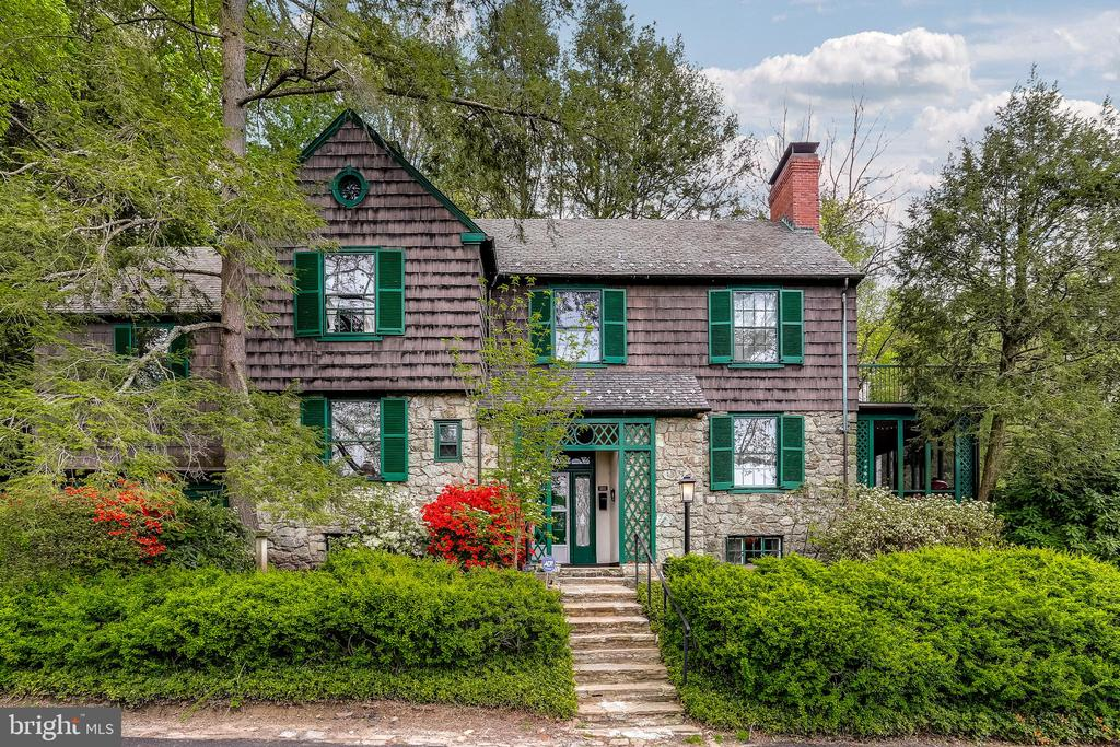 Absolutely Charming 5BR, 4/1BA Stone and Cedar New England Style Home.  Elegant Foyer, Formal LR w/FP & access to Enclosed Porch. Beautifully Renovated Kitchen (2014) w/ Granite Countertops and SS Appliances.  Formal DR w/large bay window & FR doors to patio, Den, 1st Floor FB and HB, MBR w/Fireplace, 4 Add'l large BRs and 3 FB on 2nd floor.  Hardwood floors throughout the home.  Generous amount of storage in basement and Full Floored Storage Attic w/ cedar closet.  Flagstone Patio, Great Quiet Location!!  Make an offer....