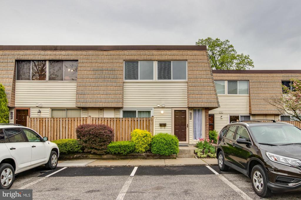 Conveniently Located 2 bedroom, 2.5 bath, 2 story condo in Pikesville location. Well maintained with updates in recent years to include replacement of storm door,kitchen/living room sliders,bdrm windows,liv/din room wood flrs,1/2 bath remodel,ample closet/storage space, fireplace in living room, sun-filled rooms, each bdrm has own bath,Large Back walkout private patio and Large Front Porch are privately screened with Fence.