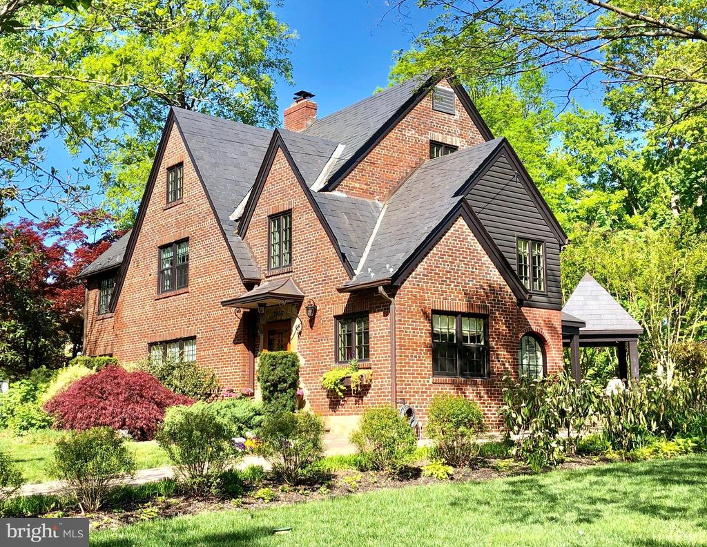 Experience the masterful luxury & elegant design in this recently restored Tudor Revival Style residence.  This one-of-a-kind, four level home is designed with attention to detail & crafted with an abundance of fine finishes that offer elegance and modern comfort.  Its sophisticated design was carefully selected to honor the original architecture along with embracing the exceptional outdoor spaces.  Its beautiful design is evidenced by distinctive ceiling moldings with raised relief squares, fifty-two, historically accurate, casement windows & doors (by Marvin) that frame exceptional views of the grounds coupled with an inviting floor plan that is perfect for entertaining.  The top-of-the-line culinary kitchen is equipped with premium finishes and professional appliances.  All bedrooms feature en-suite baths, and welcomed natural lighting.  Enjoy the magical expansive rear gardens complete with a vaulted ceiling screened-in porch, generous stone patio, grilling pavilion and the convenience of a multi-zone irrigation system.  Drive up on the cobblestone paver driveway to the two-car carport (with attached storage compartment) with additional space on the driveway to accommodate 2 vehicles.  Located on the grand and picturesque Meadow Lane, the home stands proudly within professionally landscaped, lush grounds on a prime and scenic 10,700+ square foot lot. ***Note: In the event further expansion to the residence is desired, the deep, wide glorious lot affords great flexibility for a myriad of possibilities!!***.  This is your invitation to enjoy all the amenities of the sought-after Town of Chevy Chase, the close proximity of the vibrance of downtown Bethesda, the Bethesda Metro, theatre, award-winning B-CC schools, parks, trails, and the convenience to all three major airports and highways.