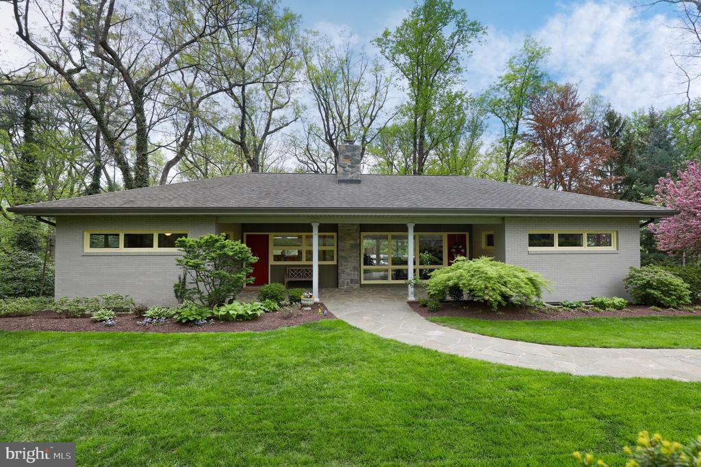 OPEN HOUSE SUNDAY MAY 5th 1-2:30*Remodeled mid-century rancher (Frank Lloyd Wright architectural elements), updated kitchen/ SS appliances, quality counters/ tile backslash.  Beautiful private wooded setting, manicured gardens, like having your own private park.  Clean dry bright finished basement w/separate entrance.  Hdwd floors, stone FP upstairs, tile FP lower level, large windows, lots of light.  Brand new possible in-law qtrs. on lower level has separate entrance with 4th BR,FR and 1/2 bath.  Oversized deck. Top notch bathrooms with custom cabinetry, walk in glass shower enclosures, whirlpool tub/shower, heated floors and tile floors/surrounds.  All OFFERS being presented Tuesday May 7th at 6 pm