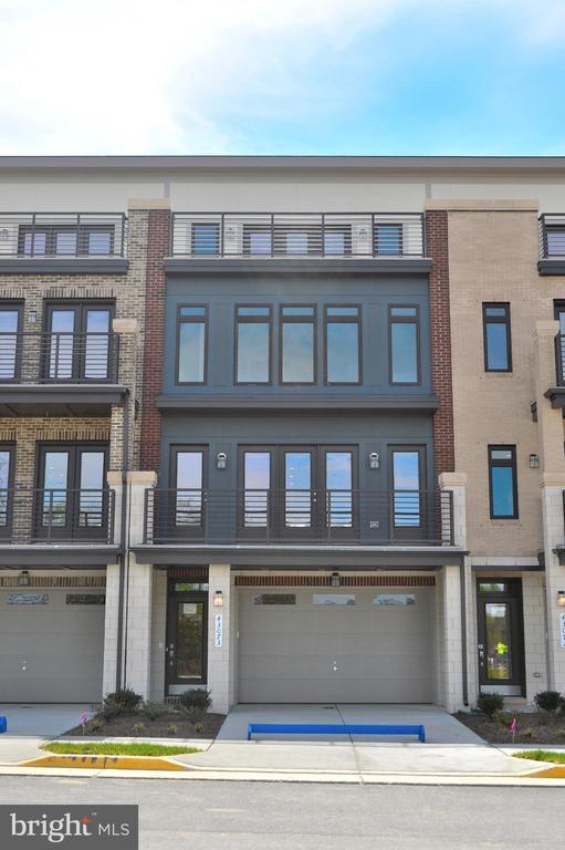 Brand new 4 level urban contemporary styled Townhome finished on 4 levels. 4th rooftop terrace is included! Amazing included features. Neighborhood is just a few minutes away from popular resturants, entertainment and grocery stores. Direct access to Washington and Old Dominion Trail! Footpath within the neighborhood to Belmont Station Elementary School!! Great Location with easy access to the Toll Road and Route 7!!