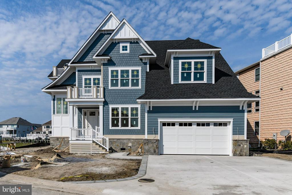 Luxurious, waterfront New Construction to be completed by Memorial Day 2019! This 6BR/5.5 BA Waterfront Single family home is the only new construction available in Heron Harbour Isle. This stunning home offers a large, eat-in kitchen with granite countertops, stainless steel appliances and plenty of cabinets for storage. Enjoy wonderful family gatherings in the great room overlooking the water. A glass sliding door leads to an oversized, low maintenance deck for relaxing times outside to watch the sunsets. There is also a first floor master suite with walk-in closet and large bathroom with double vanity and shower. Take the elevator or walk up the stairs to the second floor which offers an incredible 2nd Master Suite with his and hers walk-in closets, a large master bathroom and a separate sitting room. There are 3 more bedrooms and a spacious family room on the second floor. The third floor offers another guest bedroom, a bunk loft as well as a sitting area with a balcony. Imagine yourself in this beautiful home in one of the nicest communities in Ocean City. Heron Harbour Isle is amenity rich with two outdoor pools, an indoor pool, a kiddie pool, fitness center, social room, sauna, locker room, two Har-Tru tennis courts, sidewalks and piers. Enjoy your boat, fishing, crabbing, kayaking and paddle boarding all directly out your back door. Home includes pier and boat slip.