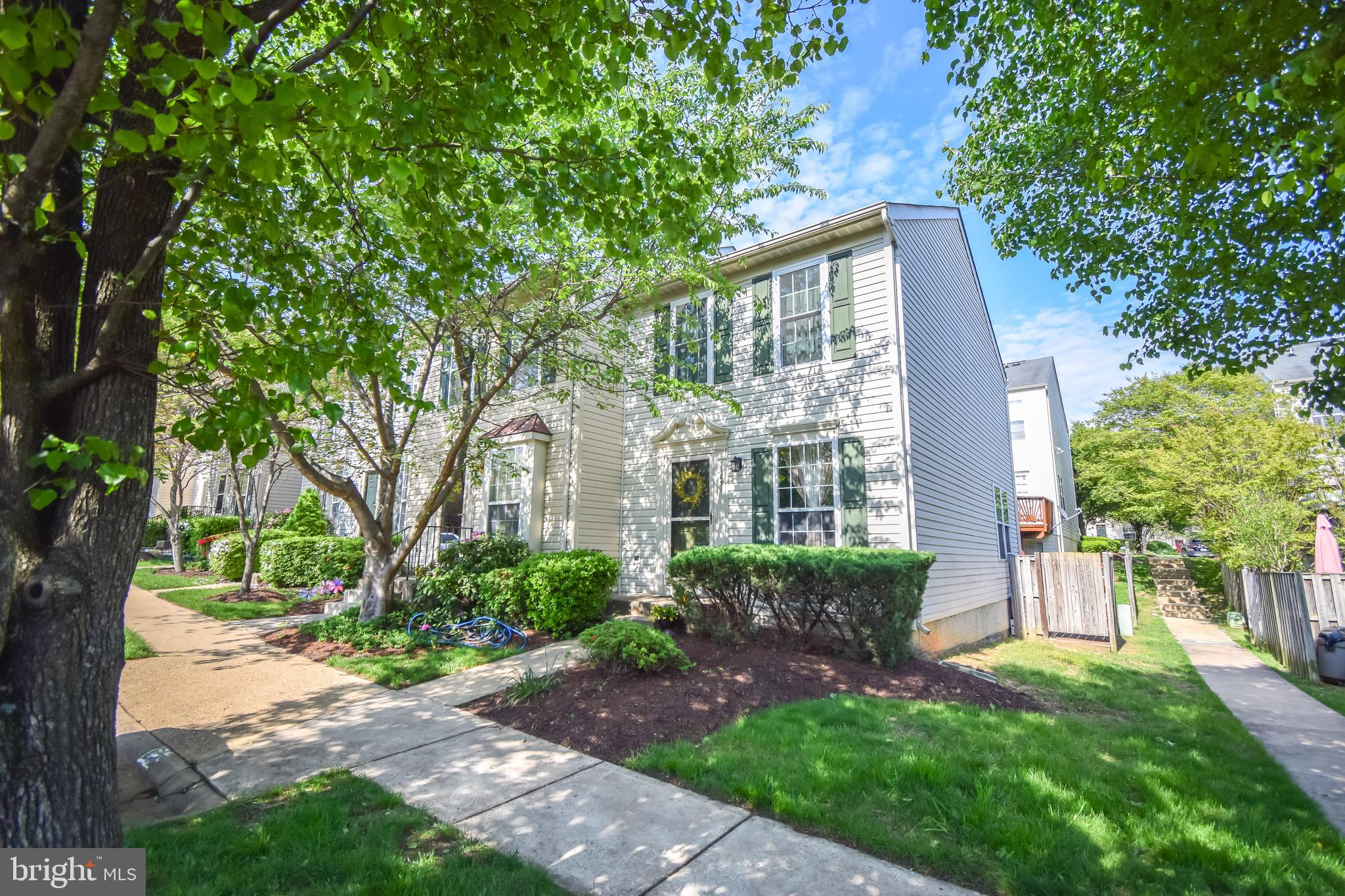 End unit alert! Open this Sunday 12-3pm!! Come check out this spacious two bedroom, two full bathroom, condo style townhome, super convenient to major transportation routes being just minutes to 95 and VRE. Head inside to main level where inviting foyer greets you with hardwood floors leading to spacious family room and large gourmet kitchen with island, stainless steel appliances and loads of cabinet space. Head upstairs to two large bedrooms with spacious master bedroom and full bathroom with his and her sinks. Head downtairs to fully finished basement with cozy gas fireplace, additional full bathroom and separate utility room with washer and dryer. Home is great for pets with fully fenced backyard with spacious deck. Water, trash, sewer and front yard maintenance included in Condo dues! Playground just steps from from door! Oversized assigned parking space just steps to front door! Check out 3D Virtual Tour here -----> https://my.matterport.com/show/?m=Gpz1R5koboL
