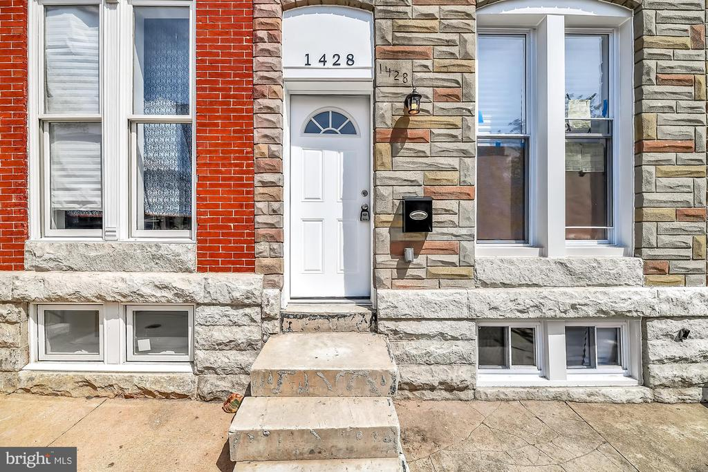 Conveniently located minutes away from Inner Harbor & Morgan University. Completely Renovated from top to bottom. This home features 4 levels of luxury living. New Roof, new windows, new HVAC, 4 new bathrooms, New Kitchen, New Wet Bar, New Rooftop Deck, New Flooring, New Water Heater. The list goes on. Walk in to your spacious living room with wood floors, ceiling fan and recessed lights. The rear of the home features a deluxe kitchen with granite, stainless steel and wood floors. The kitchen opens to eating area with wood floors. On Upper level 1 there are 2 bedrooms both with ceiling fans, new carpeting and private baths. Upper level 2 features a masterbedroom, full bath & loft space with wet bar and door leading to 2 decks one being a rooftop deck. The lower level has a full basement perfect for storage. Hurry this area is being completely revitalized as homes next door and across the street have renovation under way. Get in on the ground floor while the New Oliver community is transformed.