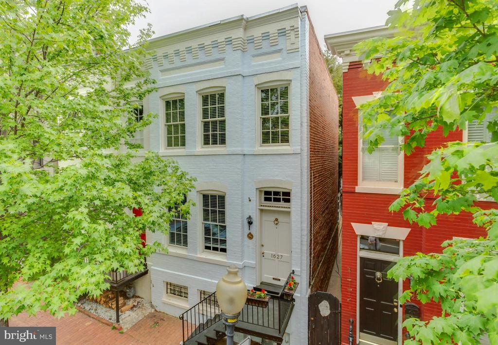 This quintessential all-brick Georgetown rowhome in the West Village is awash with natural sunlight and provides an open layout. The semi-detached property retains numerous period details including hardwood floors, a wood burning fireplace, crown moldings and skylights throughout. Additional features include custom built-ins, high ceilings, recessed lighting, stainless steel appliances and plentiful closet space. Outside, the hardscaped backyard extends entertaining potential in fair weather. 1627 33rd Street NW is located just a short walk from Volta Park, Wisconsin Avenue, M Street and countless shopping and dining venues.
