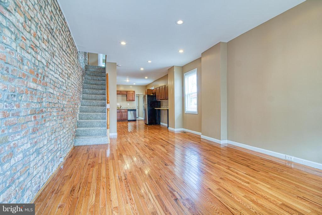 This home was fully renovated just a couple years ago and still looks amazing. Check out the exposed brick walls, gorgeous hardwood floors, front load washer/dryer, huge flat & fully fenced yard, newly painted throughout, 2 good size bedrooms with a half bath in one, huge open concept kitchen with SS appliances. Property is close to downtown, shopping, highways and MVA and public transportation. Why pay rent when you can own this beautiful home for less than you're currently paying?