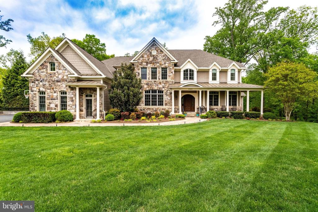 Beautiful & stately Custom Sun Filled Colonial nestled at the end of a quiet cul-de-sac on 1.3+ verdant acres. Over 9,500 Square feet of uncompromising quality & serenity for grand entertaining & family living. 3195 Araina Drive offers 6 Bedrooms 6 full and 2 half baths with a 4 car Garage. Main Level Bedroom/Office with Full Bath. Gorgeous recently refinished Mahogany Hardwoods Floors. Embassy Size Formal Dining and 2 Story Formal Living room with towering architectural Window Walls. Chefs Gourmet Kitchen with Plain and Fancy Handcrafted Custom Cabinets. Viking & Bosch Top of the line Appliances. Main Level Loggia Room with Fireplace and Hot Tub. Luxurious Master Retreat with Two walk in Closets & Built ins. Mini Kitchenette. All Bedrooms up with own Bath. Lower Level Walkout with Antique Barn Wood Flooring. Billiard/Game room, Furnished Media Room, Recreation Room, Wet Bar with Ice Maker and Commercial beverage center. A Commuters Dream Minutes to Flint Hill School, Dulles Airport, Tysons Corner.