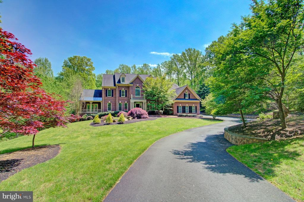 A magnificent tree-lined driveway leads to this stately brick Renaissance Grand Monet estate. No detail was spared on this 10,000+ square foot home with elegant finishes that include gleaming updated hardwood floors, updated paint and new carpet. Peaceful wooded views welcome you into this grand home that boasts an open floor plan ideal for entertaining. The gourmet kitchen offers custom cabinetry, over-sized center island with designer lighting, granite countertops, built-in refrigerator, and two dishwashers.  The spectacular two-story family room boasts dramatic backyard views and features a stone fireplace and built-in cabinetry.  Designed to accommodate gracious everyday living, this home includes formal living and dining rooms, sunroom and first floor office.  A beautiful curved staircase leads to the upper level, which includes three bedrooms, two baths, and a master bedroom featuring a sitting area with gas-burning fireplace, large walk-in closets, laundry room and an incredible master bath. A fully finished basement with elevator access, features a full kitchen, additional laundry room, recreation room, craft room, and two bedrooms with handicap accessible bath. A seamless addition includes an additional one-car garage, office and professional grade state-of-the art recording studio complete this move-in ready home.A dream come true for any musician, podcaster, or artist. This inviting haven where artists of all genres can find refuge and inspiration includes a live room, a vocal isolation booth, a second isolation booth, chamber room, private lounge and bathroom. The large master control room with oversized windows provides a perfect view of artists at work.  Additionally, there is a convenient private office. With its unique sound proof double-walled construction, leaded doors, and gorgeous tortoise shell concrete floors, this studio was designed as a comfortable and relaxing space for every aspect of recording. Meticulously designed for incredible sound, this professional grade studio boasts an elaborate ceiling structure in both the live room and the dedicated vocal isolation booth. Truly the ultimate studio for anyone who desires a professional, yet personal, creative space.This beautifully appointed estate home is in the prestigious community of Beacon Hill, located in the heart of Loudoun County Wine and Hunt Country, just west of Leesburg, Virginia.  Beacon Hill is home to many senior business executives, professional athletes, physicians, attorneys and other professionals.  This exclusive luxury home community is nestled on the rolling crest of Catoctin Mountain. Encompassing 1,100 acres, Beacon Hill is home to 225 estate and hamlet homes, surrounded by horse trails and breathtaking open space that offers beautiful views of the Blue Ridge foothills.   Once a private estate owned by 1950~s radio host Arthur Godfrey, Beacon Hill offers a unique blend of private country living with easy access to diverse employment and shopping opportunities in Loudoun County.  Beacon Hill is just 15 minutes from Dulles airport and an easy commute into Fairfax County and Washington D.C.
