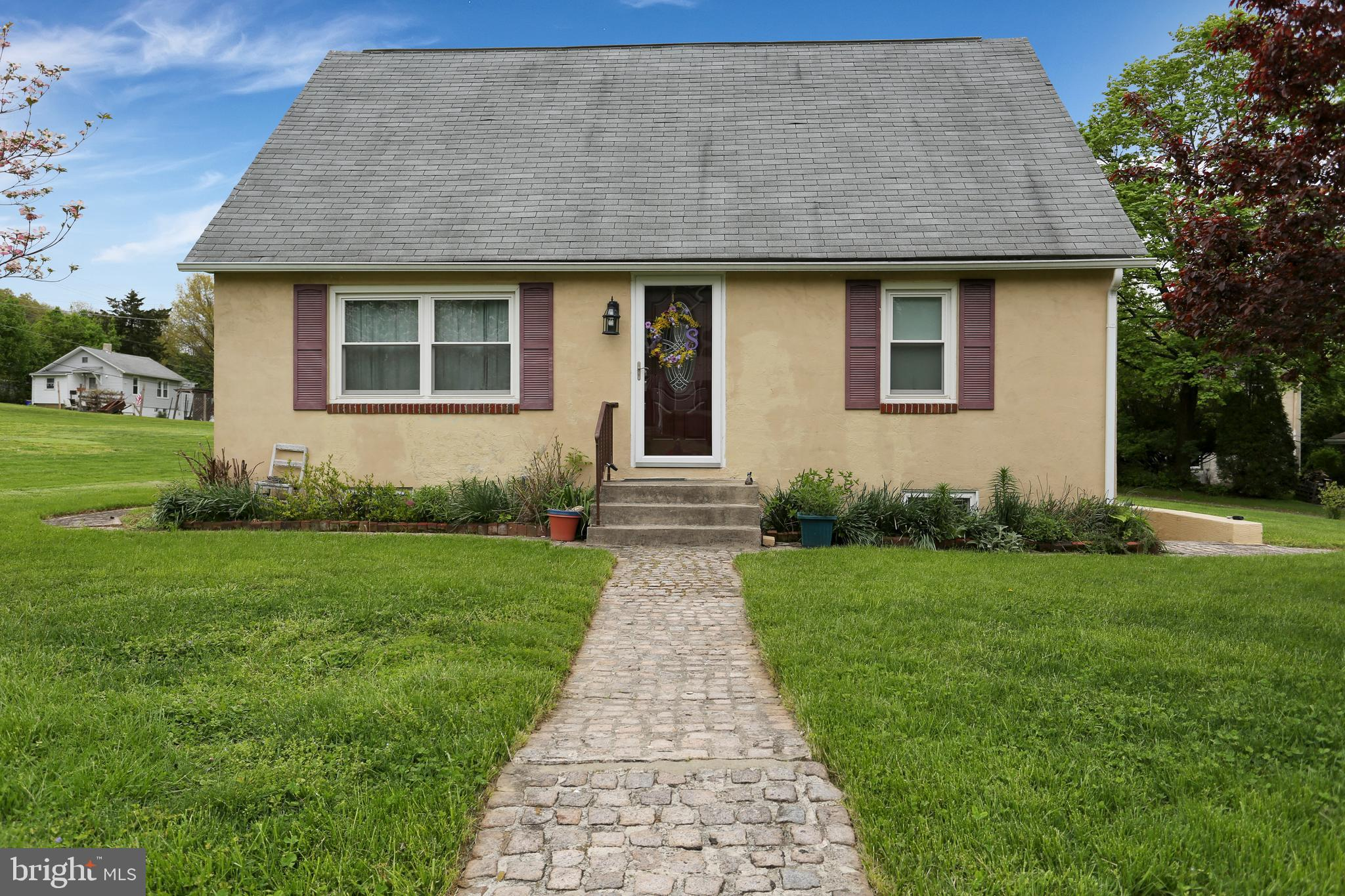 Beautiful traditional Cape Cod with two garages set on a large lot. The interior is well maintained. The bath was recently upgraded with a handicapped shower and space for a walker and/or wheel chair.