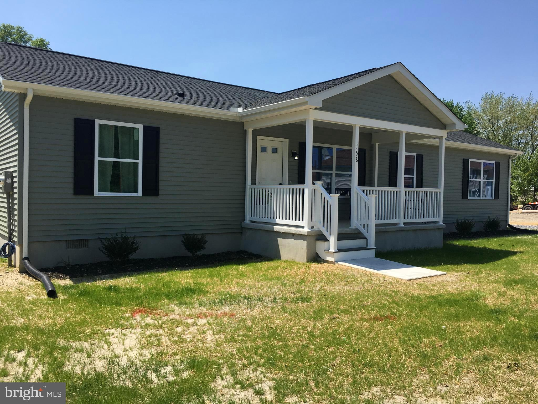 R-10867 Unique opportunity to own a brand new home on a large lot within the town limits of Hartly.  The back yard is huge and provides plenty of options.  The town is undergoing revitalization along Main Street including old homes/lots being cleared for new construction and new sidewalks.  Enjoy the benefits of small town living while still having a huge and private back yard. Sought after Hartly Elementary is just around the corner.  This spacious ranch features an open floor plan along with 3 bedrooms (all with walk in closets) and 2 full baths.  The kitchen, dining, and two living spaces are all in one large space that makes modern living and entertaining a breeze.  The kitchen includes gas cooking, stainless appliances, a large pantry, and a peninsula that's perfect as a breakfast bar.  Large front porch.  Detached, oversized 1 car garage in back.  Rear yard is huge and provides plenty of options and privacy.  Sale of this property includes parcel Tax ID # WD-10-06319-01-0700-000 (.41 acres).  The owners had the back parcel annexed within the town limits and both are being sold with this listing.  Total acreage for both parcels is .77.