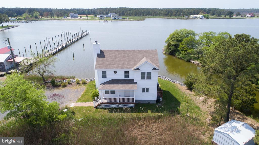 This nearly new home offers wide water views over Madison Bay!  3 BR, 2 1/2 bath home full of light and charm. Enjoy the dock, screened porch and decks during the summer, and the wood burning fireplace in the winter.  Rip rapped shoreline, and a cove full of wildlife.  You could possibly fish from the deck!  Small yard, but a big view!  Public sewer.  Energy efficient. Fully furnished.